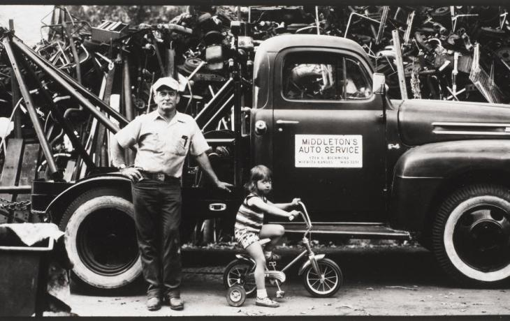 untitled (man and child in front of a tow truck) by Thaddeus Holownia