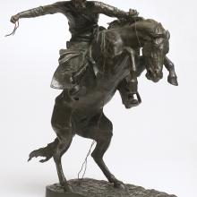 <a href='http://collection.spencerart.ku.edu/eMuseumPlus?service=ExternalInterface&module=collection&objectId=9412&viewType=detailView' target='_blank'><i>The Bronco Buster</i> by Frederic Remington</a>