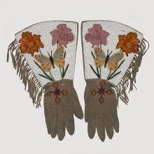 <a href='http://collection.spencerart.ku.edu/eMuseumPlus?service=ExternalInterface&module=collection&objectId=32252&viewType=detailView' target='_blank'><i>pair of beaded gauntlets (gloves)</i> by Blackfoot or Dakelh (Carrier) peoples</a>