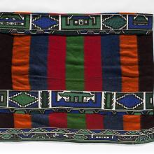 <a href='http://collection.spencerart.ku.edu/eMuseumPlus?service=ExternalInterface&module=collection&objectId=34615&viewType=detailView' target='_blank'><i>wearing blanket</i> by Ndebele peoples</a>