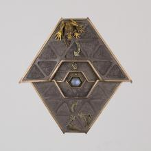 <a href='http://collection.spencerart.ku.edu/eMuseumPlus?service=ExternalInterface&module=collection&objectId=22349&viewType=detailView' target='_blank'><i>Frog Labyrinth (brooch and stand)</i> by Kevin Coates</a>