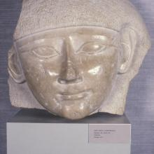 <a href='http://collection.spencerart.ku.edu/eMuseumPlus?service=ExternalInterface&module=collection&objectId=10233&viewType=detailView' target='_blank'><i>head from a sarcophagus</i> by Egypt</a>