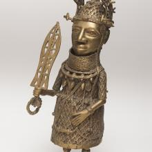<a href='http://collection.spencerart.ku.edu/eMuseumPlus?service=ExternalInterface&module=collection&objectId=31727&viewType=detailView' target='_blank'><i>oba figure</i> by Bini Peoples</a>