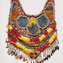 <a href='http://collection.spencerart.ku.edu/eMuseumPlus?service=ExternalInterface&module=collection&objectId=33610&viewType=detailView' target='_blank'><i>chest ornament</i> by Venezuela</a>