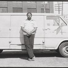 "<a href=""https://spencerartapps.ku.edu/collection-search#/object/54861"" target=""_blank""><i>untitled (man leaning against van)</i> by Thaddeus Holownia</a>"