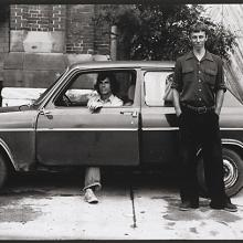 "<a href=""https://spencerartapps.ku.edu/collection-search#/object/54865"" target=""_blank""><i>untitled (two young men posing with car)</i> by Thaddeus Holownia</a>"
