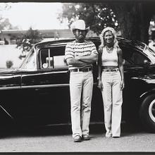"<a href=""https://spencerartapps.ku.edu/collection-search#/object/54867"" target=""_blank""><i>untitled (couple in front of a car)</i> by Thaddeus Holownia</a>"