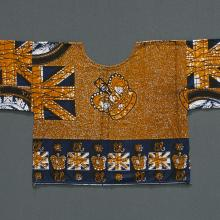 <a href='http://collection.spencerart.ku.edu/eMuseumPlus?service=ExternalInterface&module=collection&objectId=43860&viewType=detailView' target='_blank'><i>woman's shirt with Queen Elizabeth II</i> by Hausa-Fulani peoples</a>