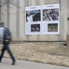 A student looks on Bell's <i>Venus Williams</i> installation on the side of Haworth Hall on KU's Lawrence campus. This artwork is part of Bell's <i>Counternarratives</i> series.