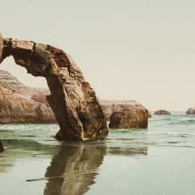 <a href='https://spencerartapps.ku.edu/collection-search#/object/45159' target='_blank'><i>Arch Rock, Santa Cruz, California.</i> by William Henry Jackson</a>